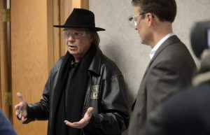 Neil Young takes a tour of the Poet laboratory with company founder, Jeff Broin Friday afternoon on a stop of his cross country road trip to promote ethanol and sustainable fuels in a converted 1959 Lincoln Continental, April 12, 2013. / Elisha Page / Argus Leader