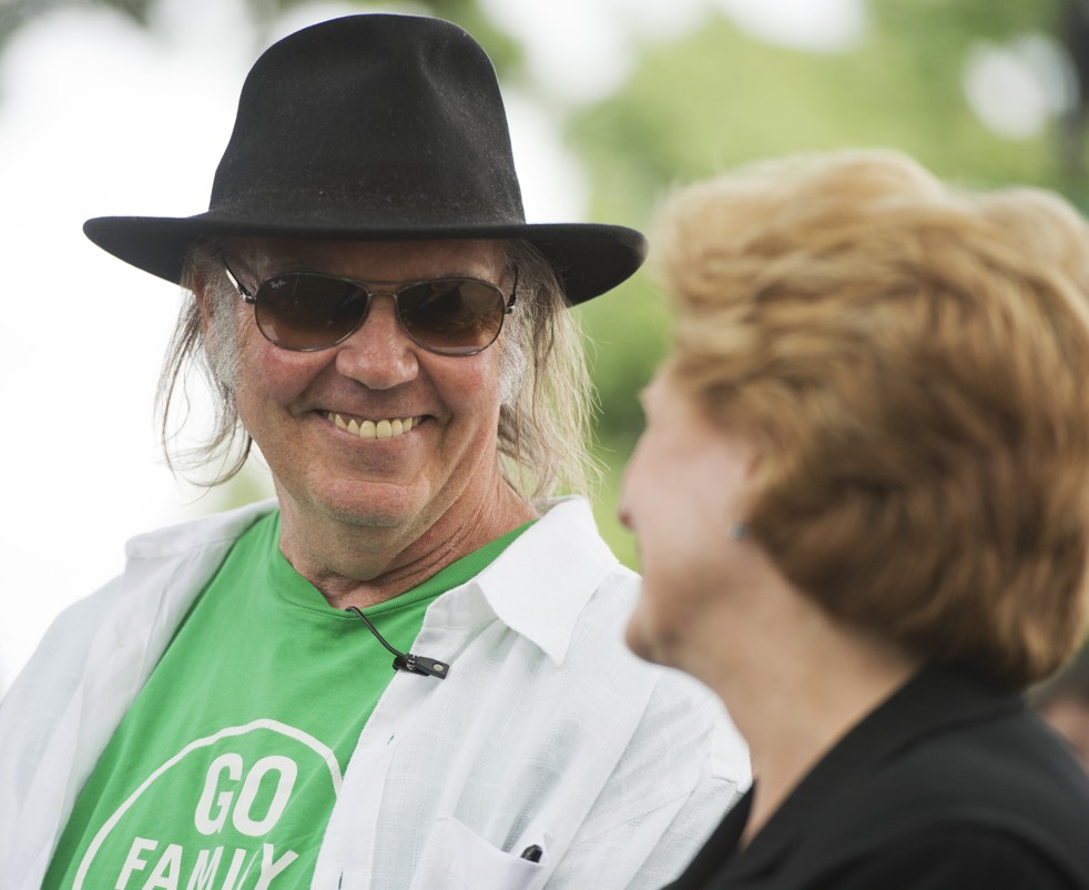 Musician Neil Young talks with Sen. Debbie Stabenow at the National Farmers Union rally on Capitol Hill Monday. (Tom Williams / CQ Roll Call via Getty Images)