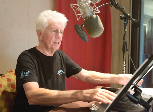 Singer Graham Nash prepares during the recording session for the audio book version of his Wild Tales: A Rock & Roll Life autobiography. Photograph by: Richard Drew  AP