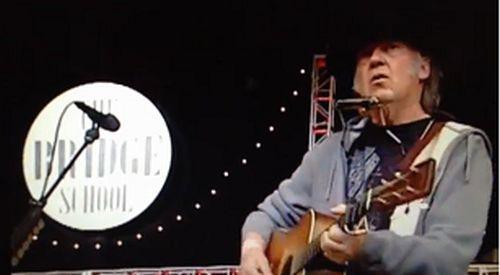 Neil-Young_Bridge-School_2013_blowin