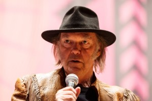 Singer Neil Young speaks during a press conference for the Honour the Treaties tour in Toronto, Sunday January 12, 2014. Photograph by: Mark Blinch , THE CANADIAN PRESS