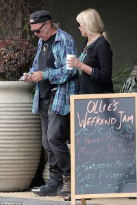 Neil young with foot brace