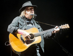 Rock 'n' roll songwriting legend Neil Young performs during an acoustic set on stage on Saturday, July 11, 2015, at Pinnacle Bank Arena. FRANCIS GARDLER/Lincoln Journal Star